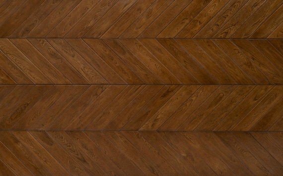Chevron 45° wood floor in Oak: smoked, aged effect, hand carved, stained, varnished.