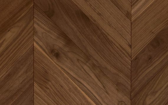 Chevron 45° wood floor in American Walnut: sanded, varnished.