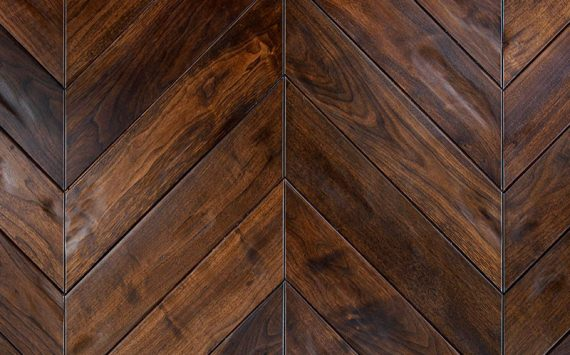 Chevron 45° wood floor in American Walnut: aged effect, hand carved, stained, varnished, rounded bevels.