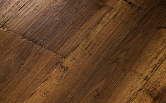 Engineered wood planks floor in European Walnut: hand planed, aged, stained, varnished.
