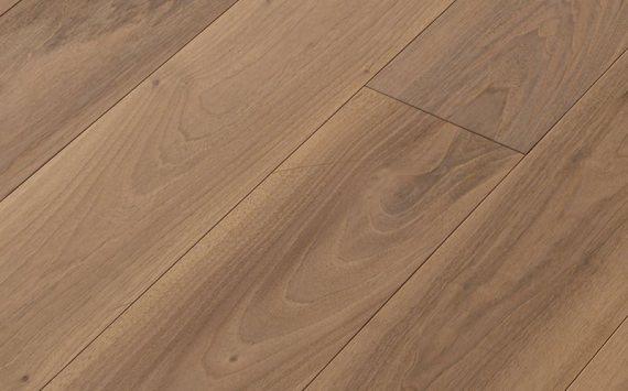 Engineered wood planks floor in European Walnut: brushed, bleached, varnished.