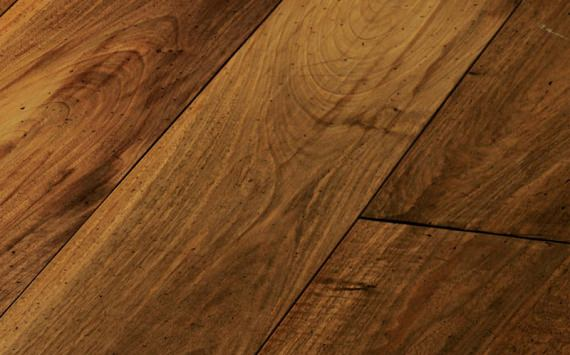 Engineered wood planks floor in European Walnut: hand planed, aged, stained, oiled and waxed.