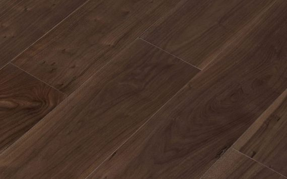 Engineered wood planks floor in American Walnut: brushed, stained, varnished.