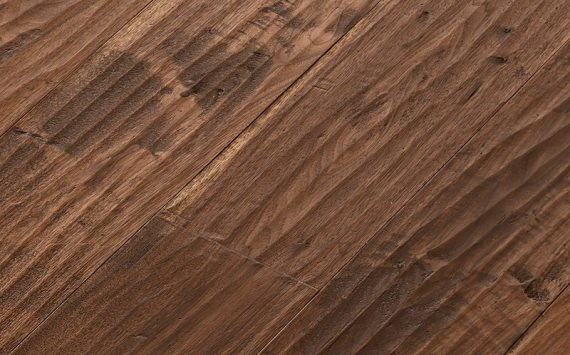 Engineered wood planks floor in American Walnut: hand planed, aged, stained, varnished.
