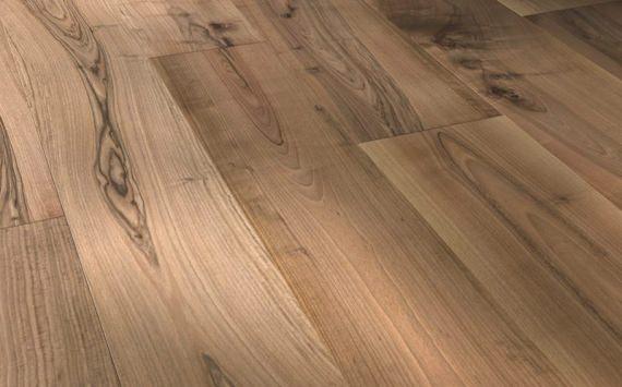 Engineered wood planks Jumbo floor in European Walnut: brushed, varnished.